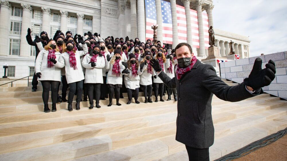 Dr. Cameron LaBarr poses for a photo with the Missouri State University Chorale on the steps of the Missouri capitol building.
