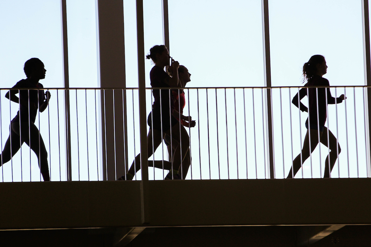 Silhouette of runners on track