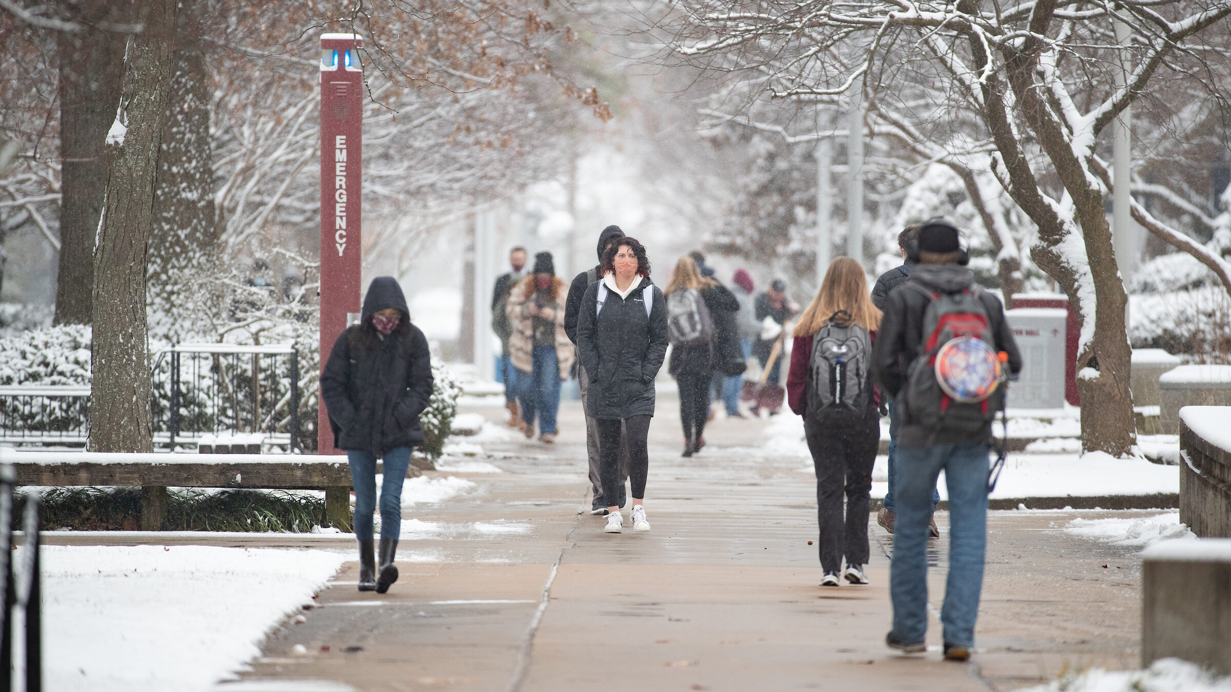 Students walk on campus in the snow