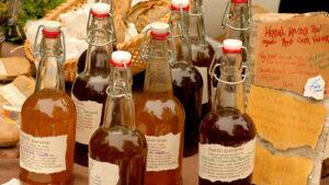 Glass bottles filled with apple cider vinegar.