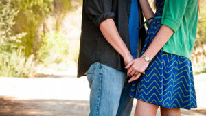 A heterosexual couple holding hands.