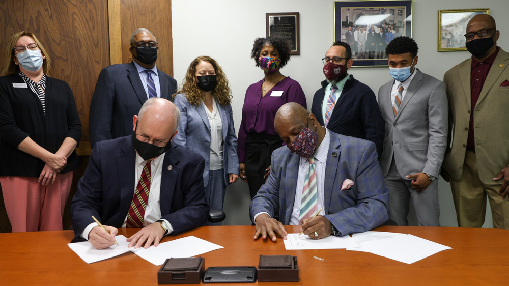 Missouri State President Clif Smart and SAAB CEO Dr. Tyrone Bledsoe sign the scholarships agreement.