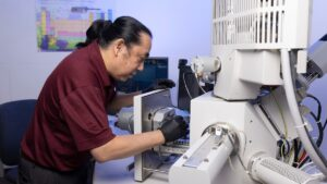 Dr. Ridwan Sakidja prepares his equipment for an experiment.