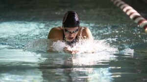 Swimmer comes up for air during race.