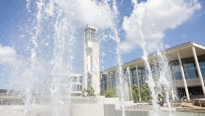 Fountain with library in background.