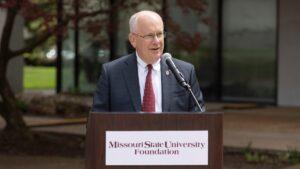 President Clif Smart speaks at the groundbreaking ceremony for the John Goodman Amphitheatre.