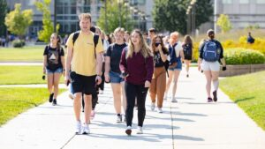 Students walk to their next classes on a sunny September day.