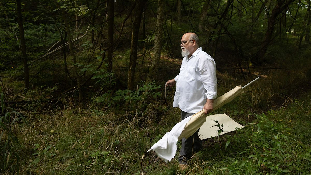 Dr. Claborn preparing to drag through conservation sites in search for ticks