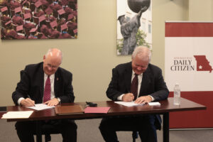 Clif Smart and Tom Carlson sign the MOU.