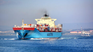 Container ship making way to port.